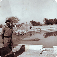 Brig. Hari Singh standing at Ichhogil Canal just 14 Miles from Lahore (Pakistan)