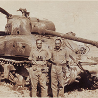 Major R.Christian and Brig. Hari Singh with a destroyed Sherman Tank of Pakistani Army.